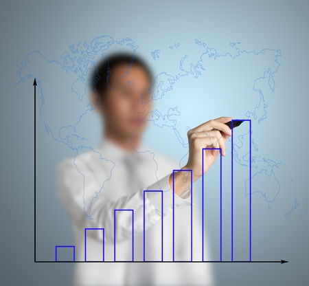 businessman drawing upward trend bar chart with world map Stock Photo - 13241745