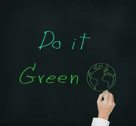 hand writing environmental concern concept   do it green   on chalkbord photo