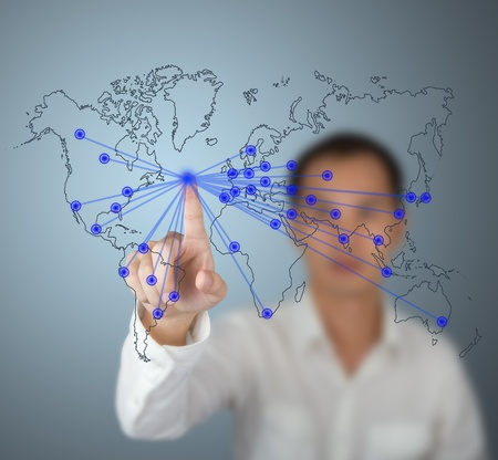 virtual world: business man pointing at contact center touchscreen button Stock Photo