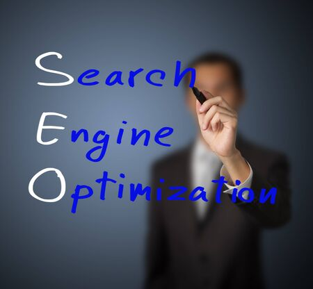 business man writing internet marketing concept of search engine optimization   SEO   photo