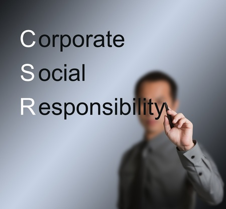 conscience: business man writing corporate social responsibility   CSR   concept Stock Photo