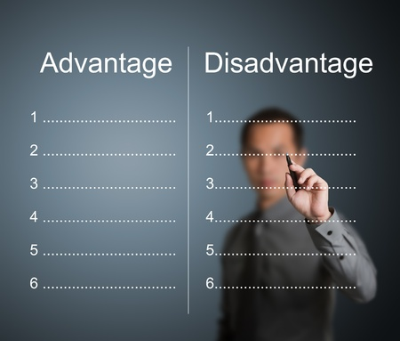 comparison: businessman writing comparing list of advantage and disadvantage Stock Photo