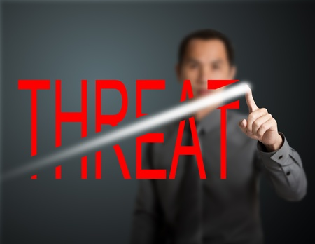 business man breaking through threat Stock Photo - 13241655