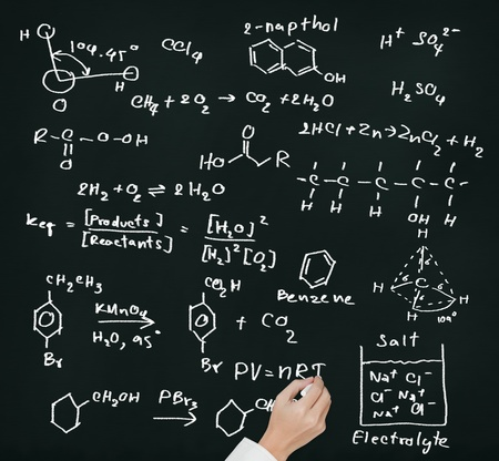 equation: teacher hand writing science and chemical formula on chalkboard Stock Photo