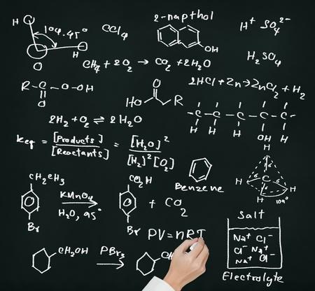 inorganic: teacher hand writing science and chemical formula on chalkboard Stock Photo