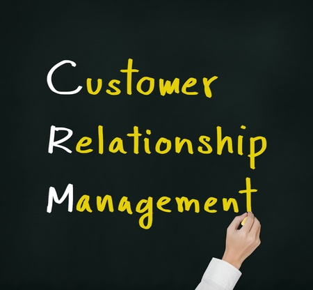 mano che scrive Customer Relationship Management concetto di CRM photo