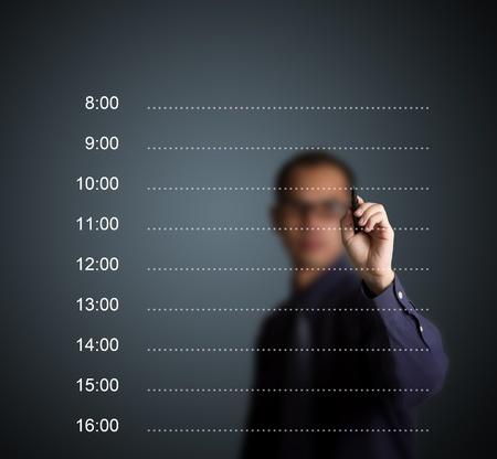 hombre escribiendo: hombre de negocios por escrito horario de cita en blanco Foto de archivo