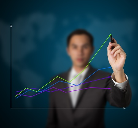 better business: businessman drawing abstract graph of green business leading the world Stock Photo
