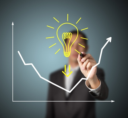 businessman drawing graph to show that big idea can change business trend from downward to upward photo