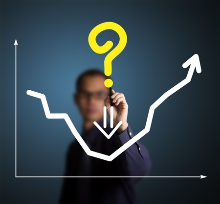 upward graph: business man ask for solution by writing question mark on graph
