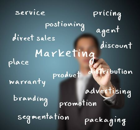 businessman writing marketing concept photo