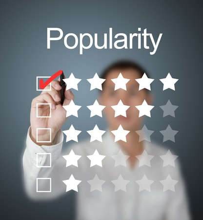 business man choosing  five star popularity choice by making red mark photo
