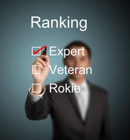 fulfillment: businessman make red mark on expert ranking Stock Photo