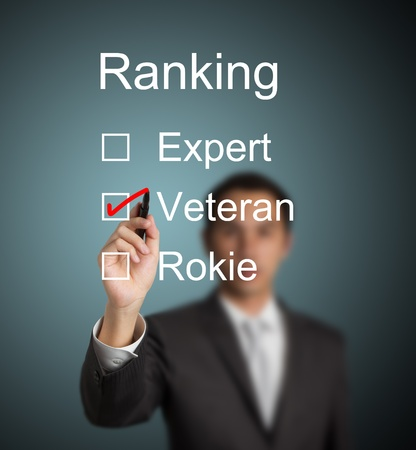 businessman make red mark on veteran ranking photo