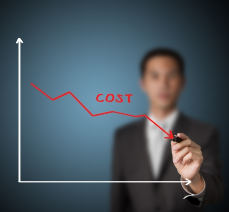downward: businessman drawing graph of cost reduction