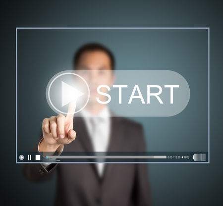 touch screen interface: business man pressing start button to play video clip