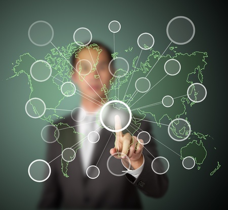 centric: businessman pressing  centric link touchscreen button on green world