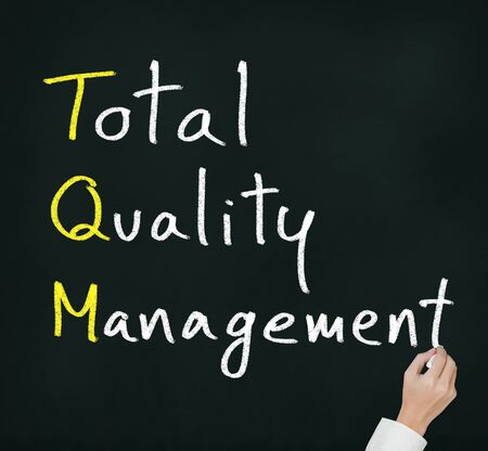 total: hand writing total quality management (TQM) concept for business and industry Stock Photo
