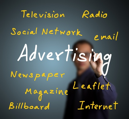 business man writing advertising concept with various media type