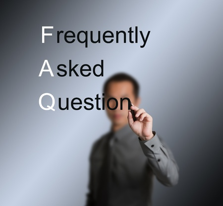 frequently: business man writing frequently asked question ( FAQ ) concept for website service
