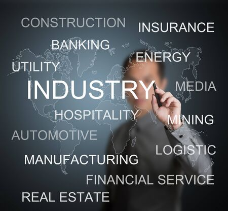 business man writing various kind of industry in the world Stock Photo - 13282222