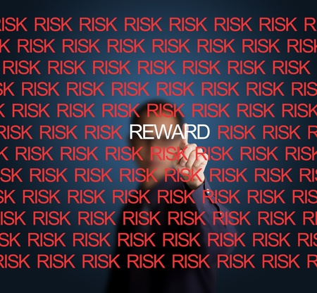business man showing that there is reward among risk photo