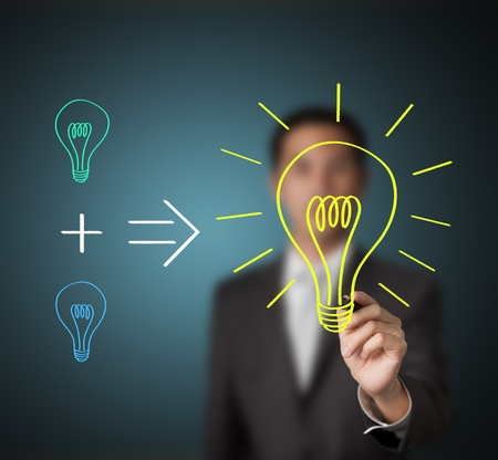 to think: business man writing concept - small different ideas can produce new big idea Stock Photo