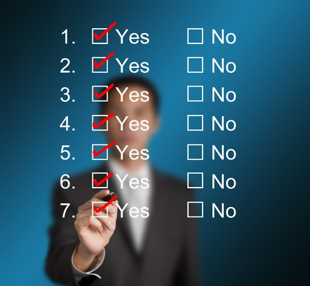 every: business man answering questions by make red mark on all yes