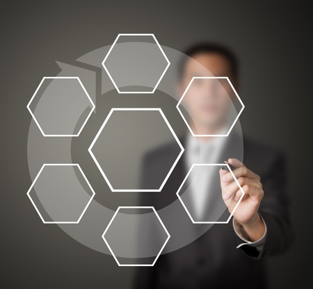 business man drawing one core and six clockwise stage flow component diagram Stock Photo - 13417091