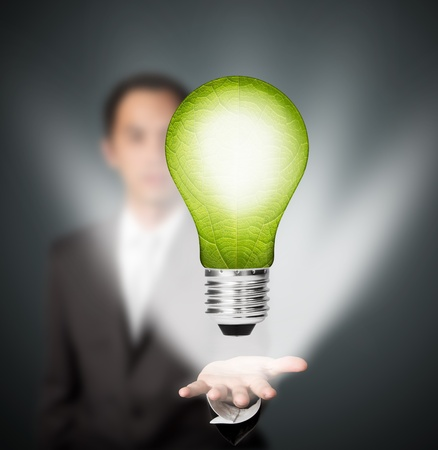 business man holding  eco green energy light bulb, future innovation concept photo