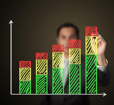 business man drawing growth stack bar chart photo