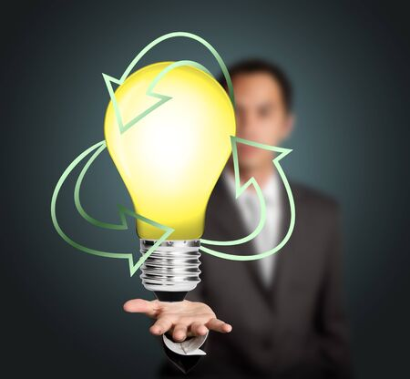 business man holding recycle energy light bulb Stock Photo - 13613180