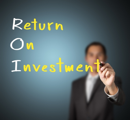 return on investment: businessman writing return on investment   ROI   concept on whiteboard