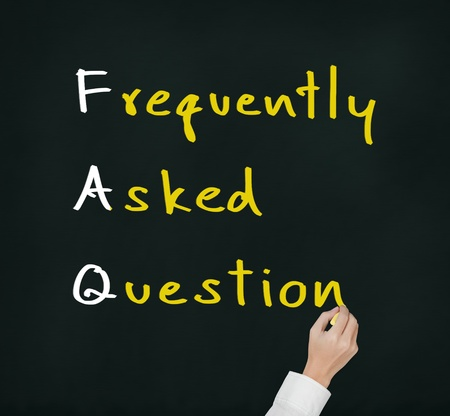 hand writing frequently asked question   FAQ   concept for website service on chalkboard photo