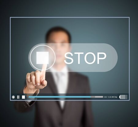 watch video: business man push stop button on touch screen to end video clip