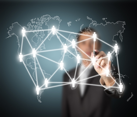 business man writing global social network or people management connection diagram photo