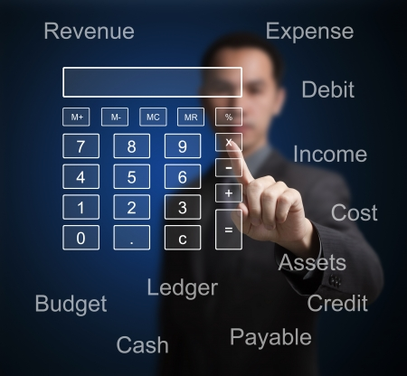 business man pointing at calculator and accounting concept on computer touchscreen photo