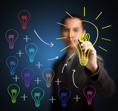 business man writing concept of  combining of many different small idea is one big great idea photo