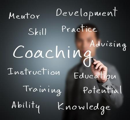 business man writing coaching concept photo
