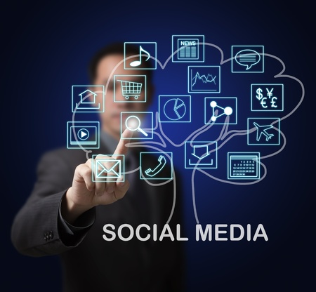 social media marketing: business man showing that social media are the root of many online internet application marget growth Stock Photo