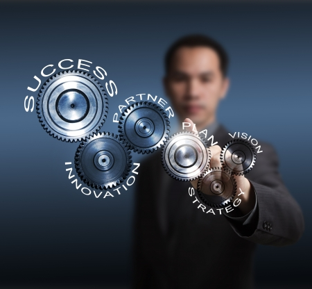 business man driving business process gear of vision - strategy - plan - partner - innovation - success Stock Photo - 14019947