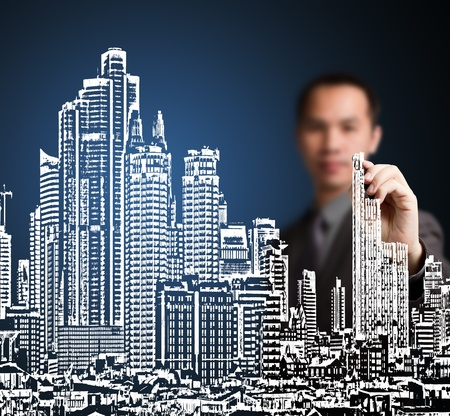 construction: business man drawing industrial construction concept   modern urban city building   Stock Photo