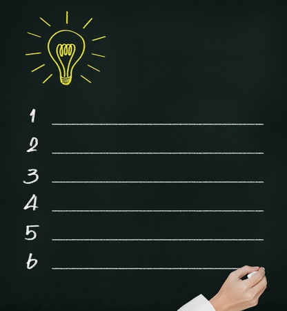 business hand writing idea or innovation list on chalkboard photo