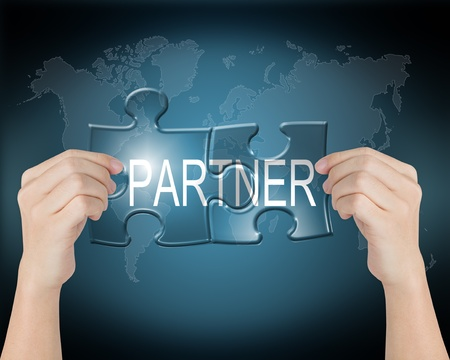 business partner: hand connect jigsaw puzzle of global partner