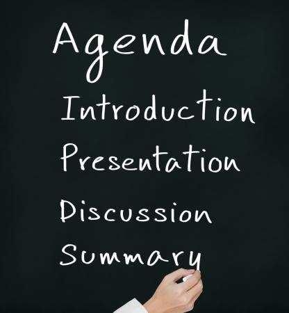 business hand writing meeting agenda on chalkboard Stock Photo - 14123810