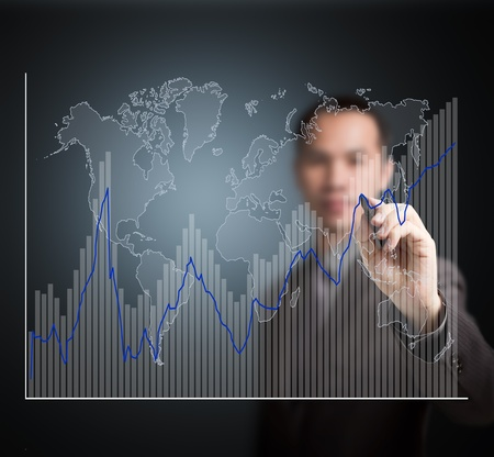 share market: business man writing fluctuate upward trend graph with world map Stock Photo
