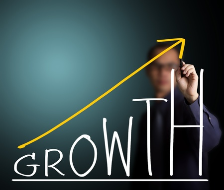growth chart: business man writing growth concept