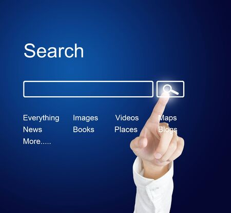 internet search: business hand clicking internet search page on computer  touch screen