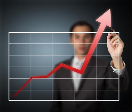 performance improvement: business man writing over achievement graph