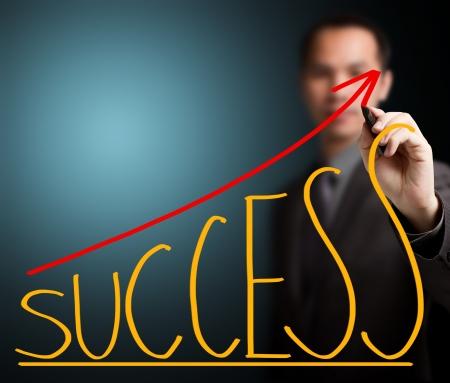 upward graph: business man writing success concept Stock Photo